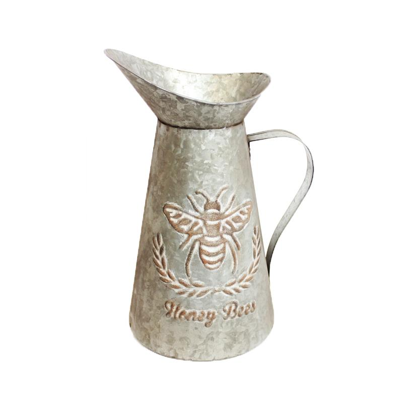 Pitcher with Bee design